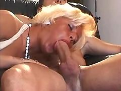 Mature shemale sucks cock