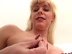 Sexy blond tranny jizzing on mirror