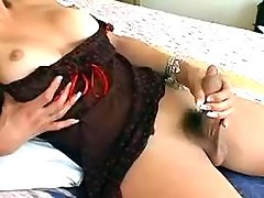 Pretty tranny plays with big dildo